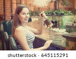 young woman holding alcohol... | Shutterstock . vector #645115291