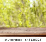 empty wooden table on spring... | Shutterstock . vector #645135325