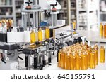 cosmetics factory. bottling... | Shutterstock . vector #645155791