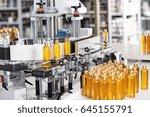 cosmetics factory. bottling... | Shutterstock . vector #645155791