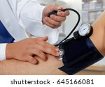 doctor measuring blood pressure ... | Shutterstock . vector #645166081