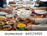 family at food table together | Shutterstock . vector #645174505