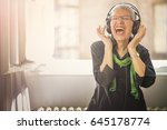 Senior Old Woman Listening To...