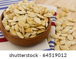 toasted pumpkin seeds scattered ... | Shutterstock . vector #64519012