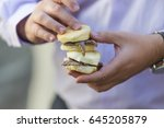 hands holding two mutton... | Shutterstock . vector #645205879