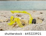 diving mask broken in the sand | Shutterstock . vector #645223921