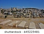Small photo of EAST JERUSALEM -10 JULY 2016- View of Jewish tombs overlooking the Arab area of East Jerusalem, which has been occupied by Israel since 1967 and controversially annexed in 1980.