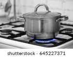 old pot on a stove | Shutterstock . vector #645227371