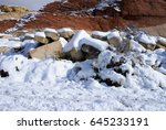snow in the desert   red rock... | Shutterstock . vector #645233191