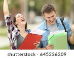 two excited students with... | Shutterstock . vector #645236209