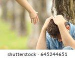 sad teen sitting on the grass... | Shutterstock . vector #645244651
