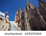 young and happy tourist woman... | Shutterstock . vector #645254344