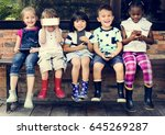group of diverse kids using... | Shutterstock . vector #645269287