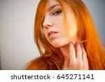 dreammy portrait of redhead in... | Shutterstock . vector #645271141