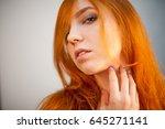 dreammy portrait of redhead in... | Shutterstock . vector #645271141