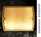 golden metal plate on concrete... | Shutterstock . vector #645303439