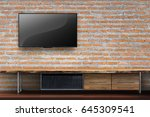 tv on red brick wall with empty ... | Shutterstock . vector #645309541