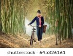 Asian Woman Walk Alone On An...