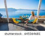 woman enjoying breakfast with... | Shutterstock . vector #645364681