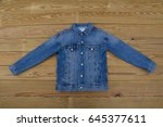 Blue Denim Jacket On Wooden...