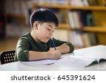 happy asian child doing... | Shutterstock . vector #645391624