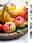 fresh fruit on old wooden plate ...   Shutterstock . vector #645432865