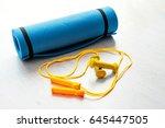fitness concept   yoga mat ... | Shutterstock . vector #645447505
