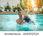 father and son funning in water ... | Shutterstock . vector #645452524