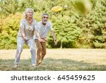 active senior couple playing... | Shutterstock . vector #645459625