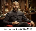 portrait of a barber.... | Shutterstock . vector #645467311