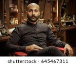 portrait of a barber.... | Shutterstock . vector #645467311