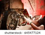 a mechanic is repairing a... | Shutterstock . vector #645477124