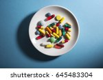 a variety of pills in a white... | Shutterstock . vector #645483304