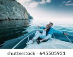 young couple relaxing on a... | Shutterstock . vector #645505921