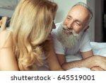 beautiful happy mature couple... | Shutterstock . vector #645519001