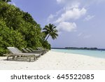 exotic beach with wooden chair... | Shutterstock . vector #645522085