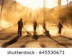 road sweeper worker cleaning... | Shutterstock . vector #645530671