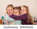 Three Little Girls Embrace
