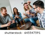 happy group of friends playing... | Shutterstock . vector #645547591