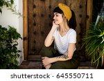 portrait of millenial traveller ... | Shutterstock . vector #645550711