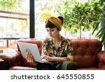 pretty brunette girl checks her ... | Shutterstock . vector #645550855