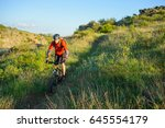 cyclist in red jacket riding... | Shutterstock . vector #645554179