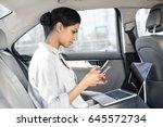 beautiful young woman sitting... | Shutterstock . vector #645572734