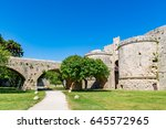 Small photo of Gate d'Amboise in Rhodes, grand gate below the Palace of the Grand Master, and bridge leading to it, Rhodes island, Greece