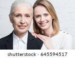 smiling women looking at camera ... | Shutterstock . vector #645594517
