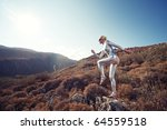 cyber woman in the mountains | Shutterstock . vector #64559518