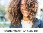 curly woman laughing and... | Shutterstock . vector #645602101