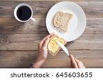 woman hand spreading butter on... | Shutterstock . vector #645603655
