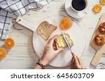 woman hand spreading butter on... | Shutterstock . vector #645603709