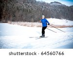 a woman cross country skiing in ... | Shutterstock . vector #64560766